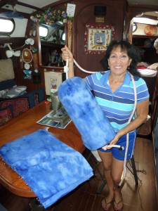Deb in process of making 8 new fender covers for Sailors Run Fabric is of fleece, already tie-dyed