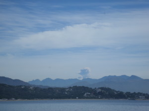 Seeing the volcano erupting from the boat at anchorage in Bahia Santiago