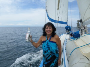 DEBBIE READY TO THROW MESSAGE IN THE BOTTLE OVERBOARD