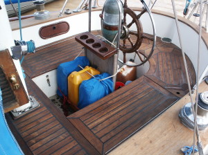 The Cockpit on Sailors Run,compartment on right goes deep down Binacle (the green round stand  in front of wheel that holds steering cables)