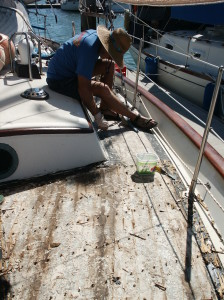PICTURE OF JEFF AFTER  HE REMOVED THE TEAK  DECKS ON SAILORS RUN IN AUSTRALIA
