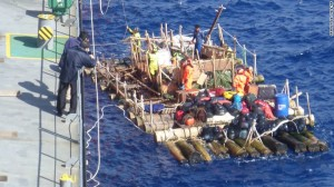 THE KON TIKI AS IT WAS BEING RESCUED AND NOW FLOATING SOMEWHERE OFF THE COAST OF CHILE